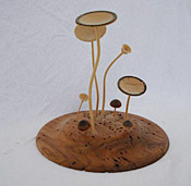 Wooden saucer with wooden mushrooms